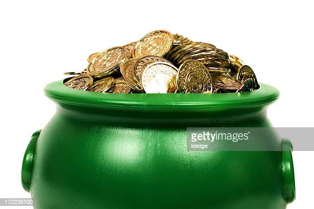 A green pot with lots of gold coins in it