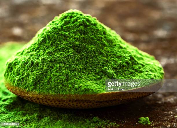 green powder - chlorophyll stock pictures, royalty-free photos & images