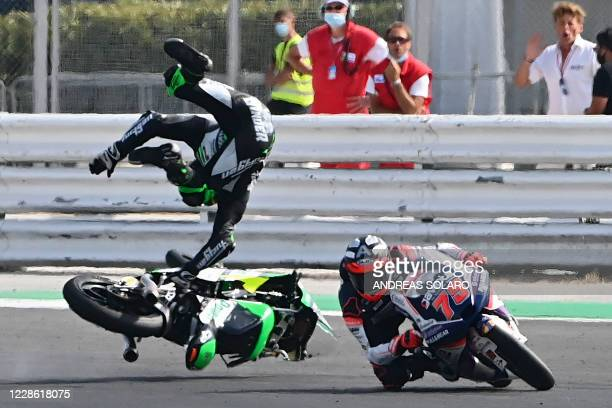 Green Power's South African rider Darryn Binder flies off his bike after he crashed during the Moto3 race of the Emilia Romagna Grand Prix at the...
