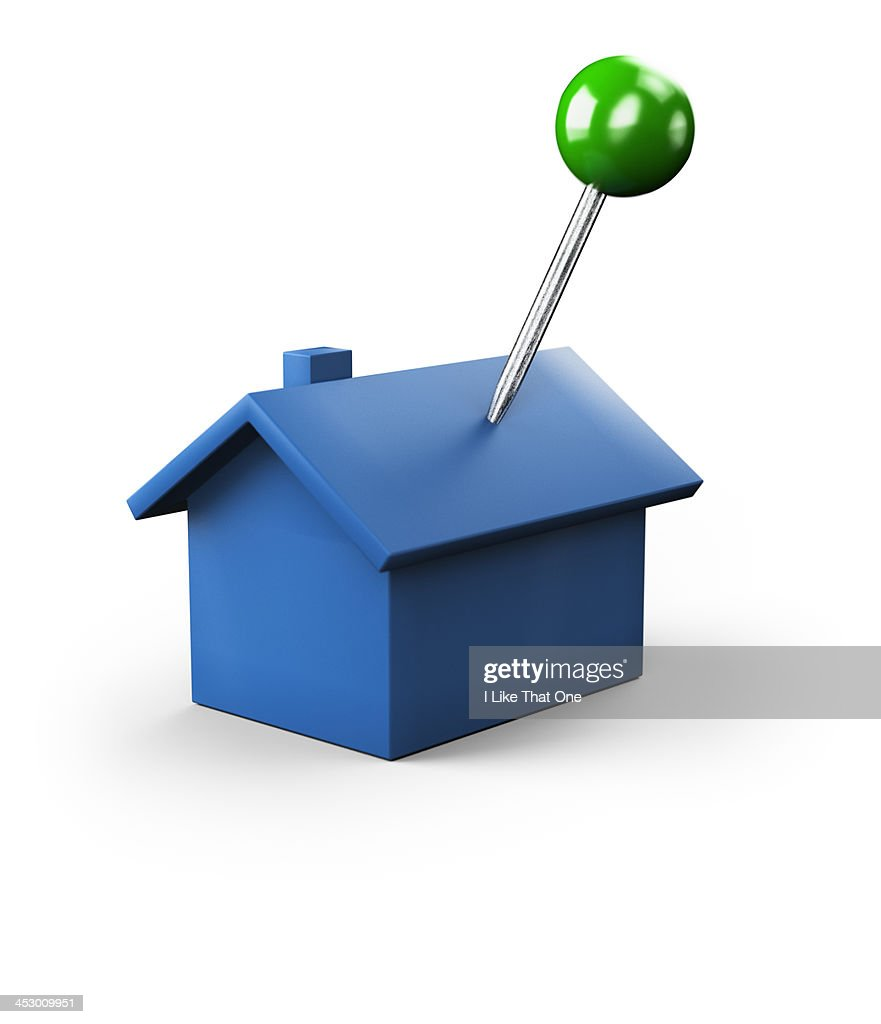 Green push pin stuck into a blue house icon : Stock Photo