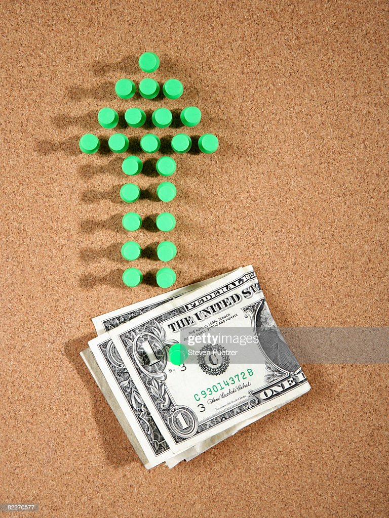 Green push pins in the shape of an up arrow  : Stock Photo