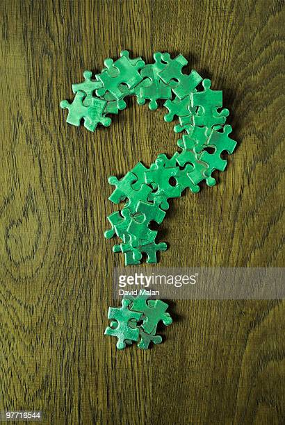 Green question mark made out of puzzle pieces