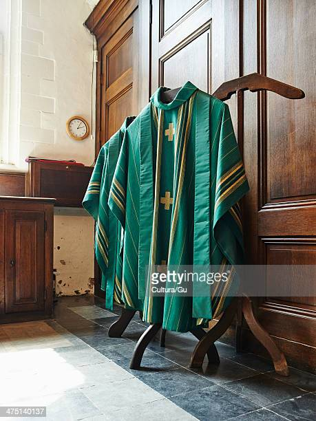 Green religious robes hanging in church interior