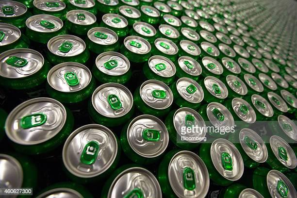 Green ringpulls sit on cans of Carlsberg beer as they move along the production line at the OAO Baltika brewery operated by Carlsberg A/S in Saint...