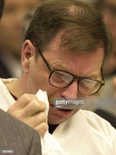 Green River Killer Gary Leon Ridgway cries in a King County Washington Superior Court December 18 2003 in Seattle Ridgway received 48 life sentences...