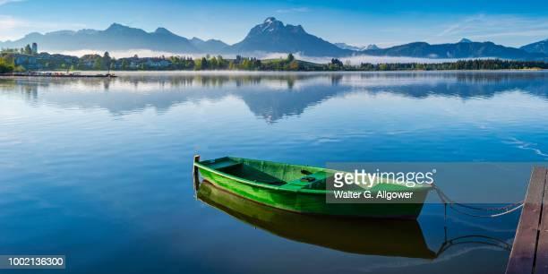 Green rowboat, lake Hopfensee, Hopfen am See, near Fuessen, Ostallgaeu, Allgaeu, Bavaria, Germany