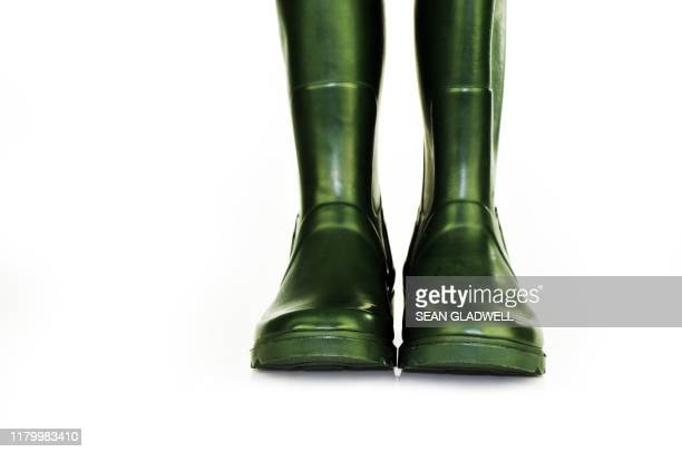 green rubber boots - pair stock pictures, royalty-free photos & images