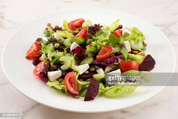 green salad with beetroot, asparagus, lentil and tomato - green salad stock pictures, royalty-free photos & images