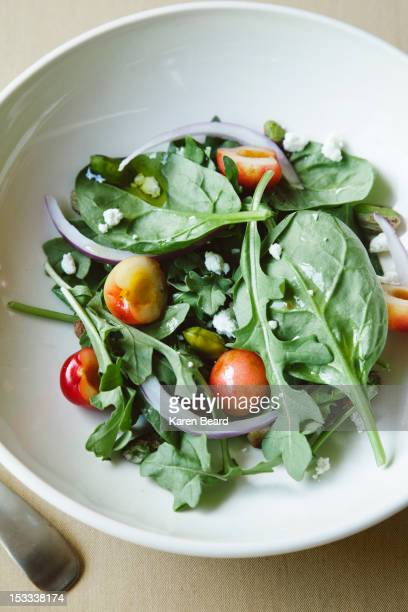 green salad with cherries - green salad stock pictures, royalty-free photos & images