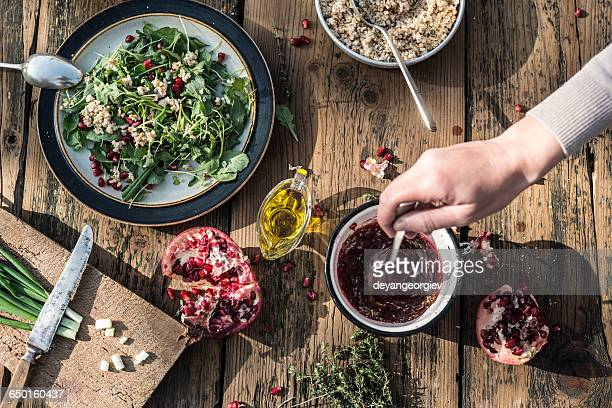Green salad with pomegranate, manna croup and onion