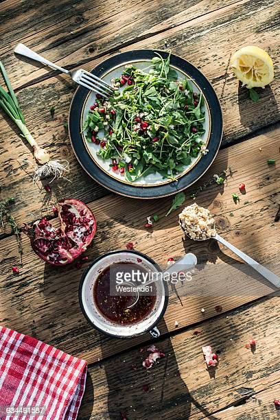 Green salad with pomegranate, manna croup, spring onion, pomegranate dressing