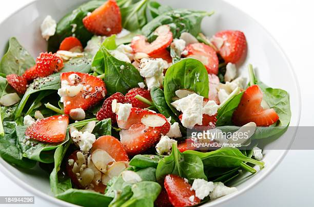 green salad with strawberries and spinach - salad stock pictures, royalty-free photos & images