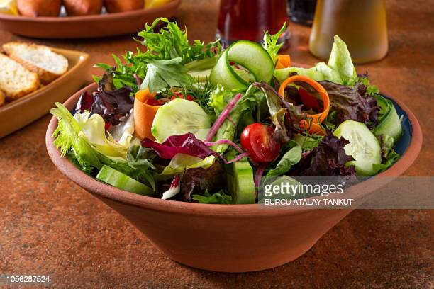 green salad with tomato and seasonal herbs - green salad stock pictures, royalty-free photos & images