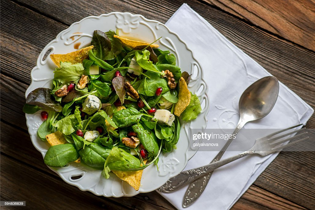 Green salad with tortilla chips : Stock Photo