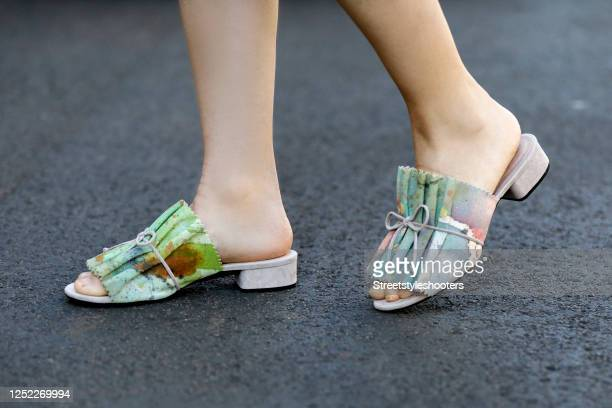 Green sandals by Mime et moi x Anna van den Hoevel as a detail of actress and TV host Katrin Wrobel during a street style shooting on June 16, 2020...