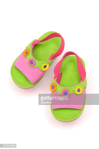 green sandals for a child with a floral design