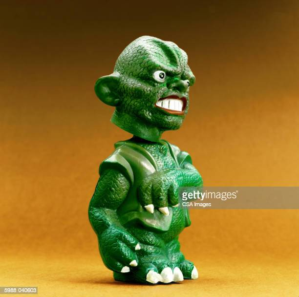 green scaly monster toy - scary monster ストックフォトと画像