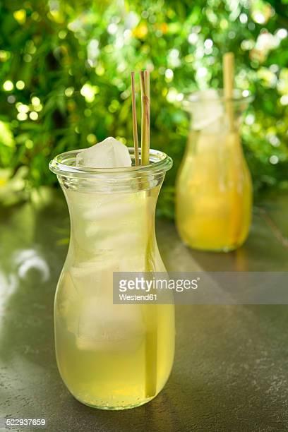 Green Sencha tea in a tea glass with lemongrass