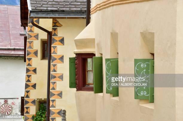 Green shutters of a house, Guarda, Scuol, Engadin, Canton of Graubunden, Switzerland.