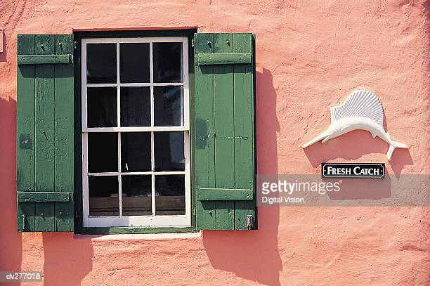 Green shutters on pink building