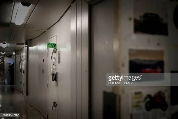 A green sign displayed by an inmate through his cell door reading 'please' to ask for a visit of a prison supervisor is pictured on December 14 2017...