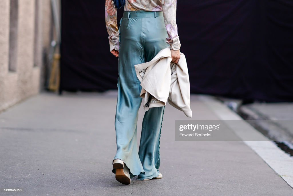 Green silk flared pants , outside Acne Studios, during Paris Fashion Week - Womenswear Spring Summer 2019, on July 1, 2018 in Paris, France.