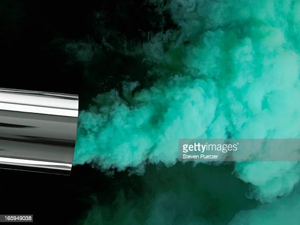 Green smoke coming from car exhaust pipe