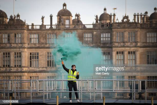 A green smoke flare indicates conditions for flying are good and is shown to balloonists gathering at Longleat on September 15 2018 near Warminster...