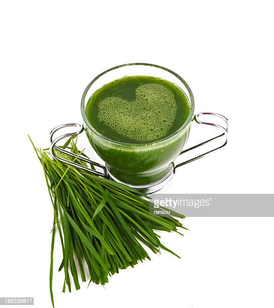 green smoothie in glass mug with heart shaped froth - chlorophyll stock pictures, royalty-free photos & images
