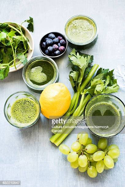 Green smoothie with celery, lemon, grapes and blueberries