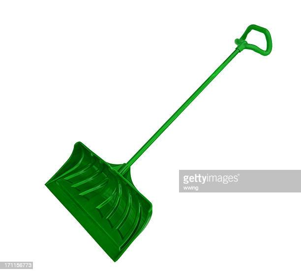 green snow shovel - snow shovel stock photos and pictures