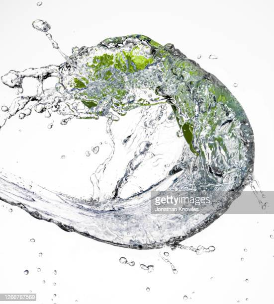 green sock in water - flowing water stock pictures, royalty-free photos & images