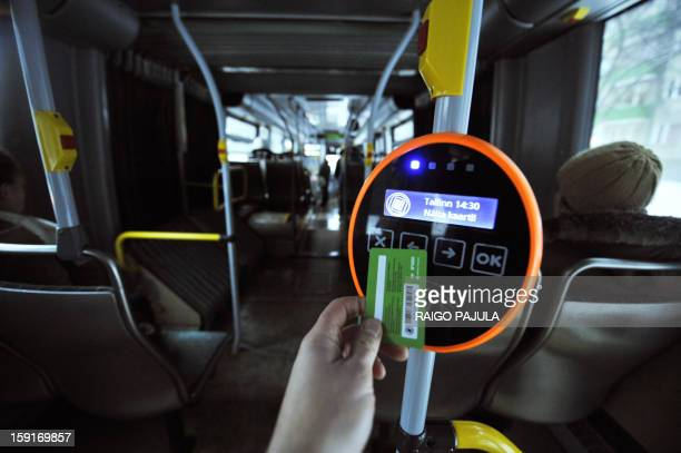 A green special card is hold to a reading device in a bus in Tallinn on January 9 2013 From January 1 residents of the Estonian capital can use...