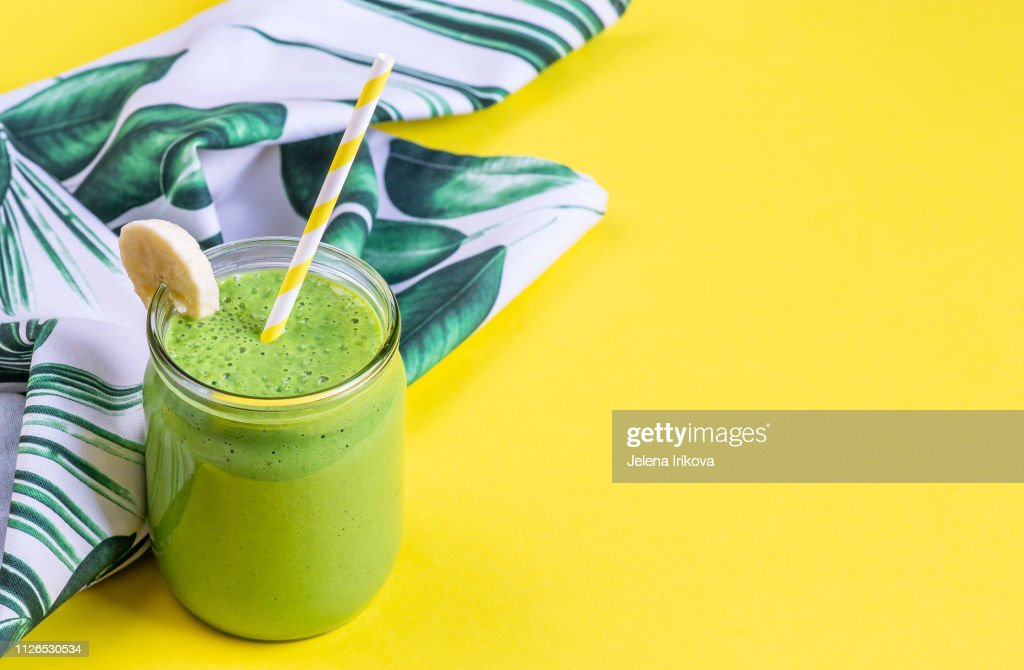 Green spinach smoothies in jar with chia seeds, healthy food concept, breakfast, yellow background : Stock Photo