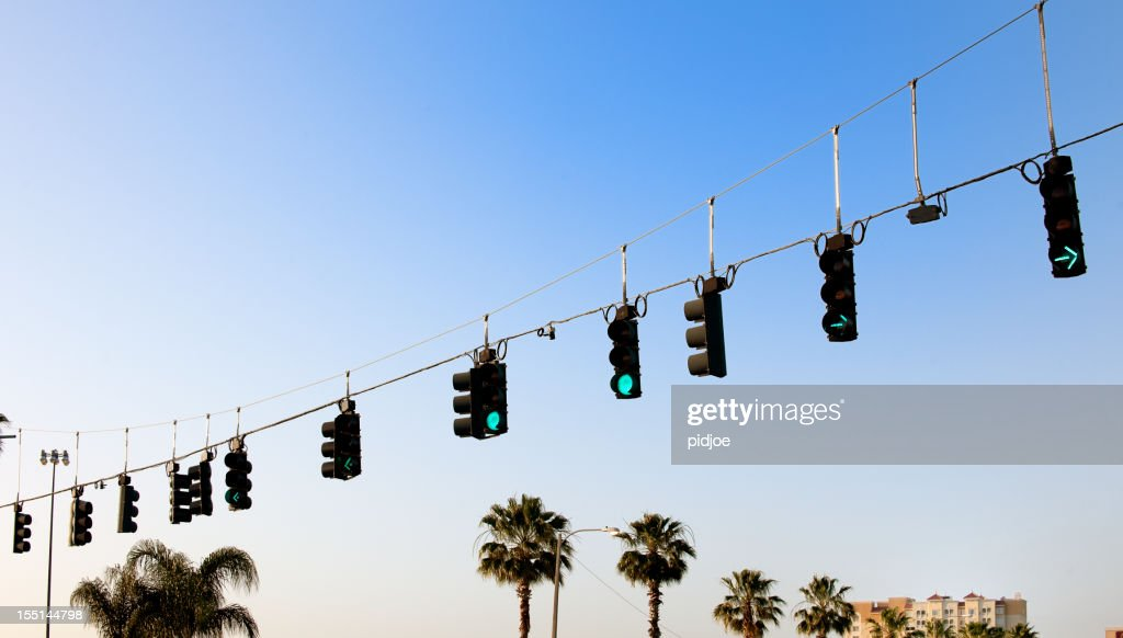 Green Stoplights On Cables At Road Intersection Stock Photo | Getty ...