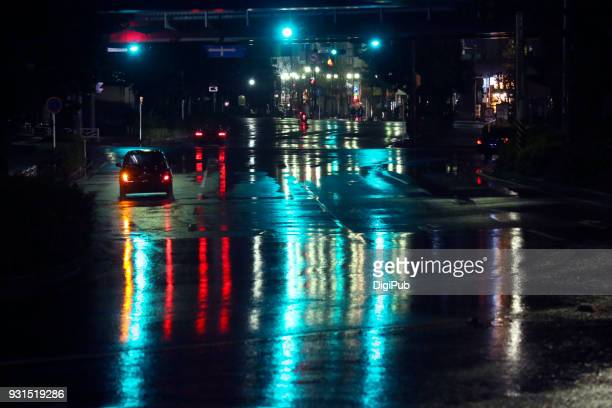 green stories: city in the rainy night - pedestrian stock pictures, royalty-free photos & images