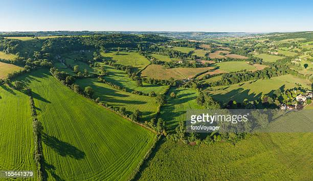 green summer fields country villages idyllic rural landscape panorama - overhemd en stropdas stock pictures, royalty-free photos & images