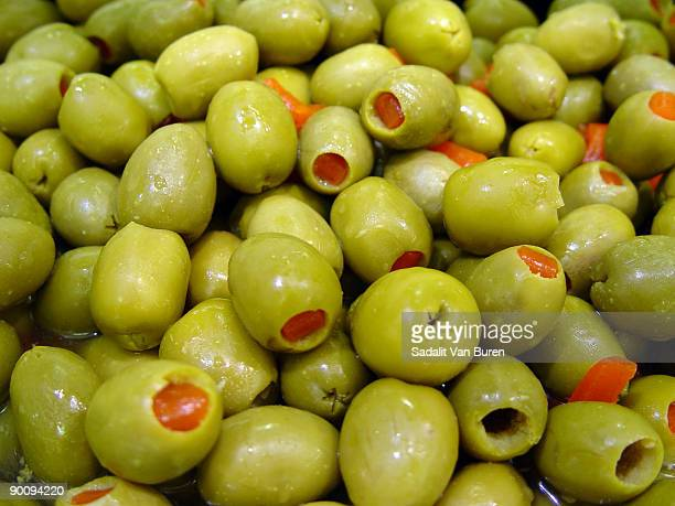 green supermarket olives - olive pimento stock photos and pictures