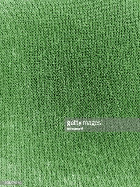 green sweater background - jumper stock pictures, royalty-free photos & images
