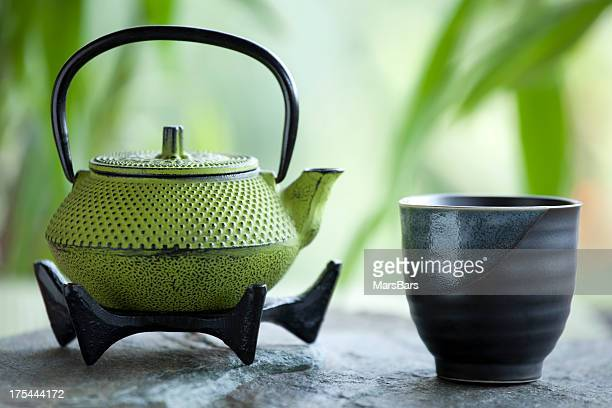 Green tea and cast iron teapot