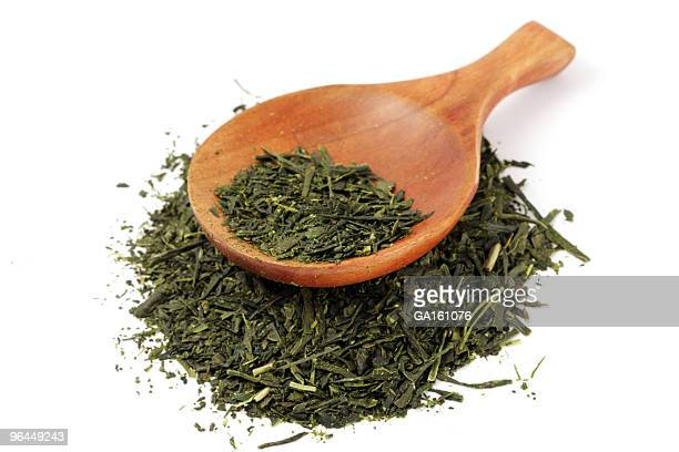 Green tea and wooden spoon