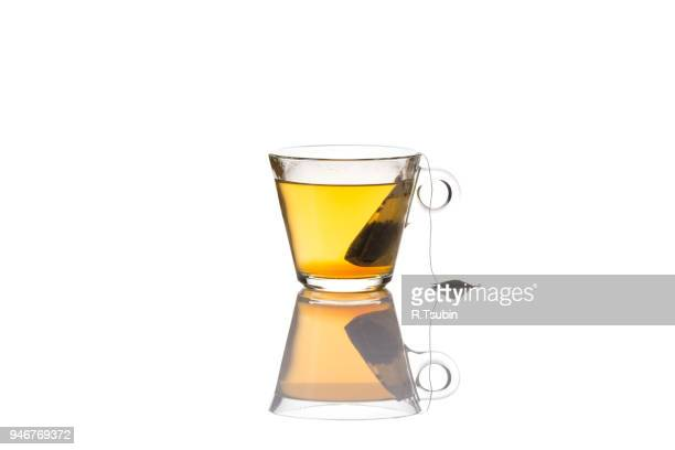 green tea glass cup with bag, isolated on white background - herbal tea stock pictures, royalty-free photos & images