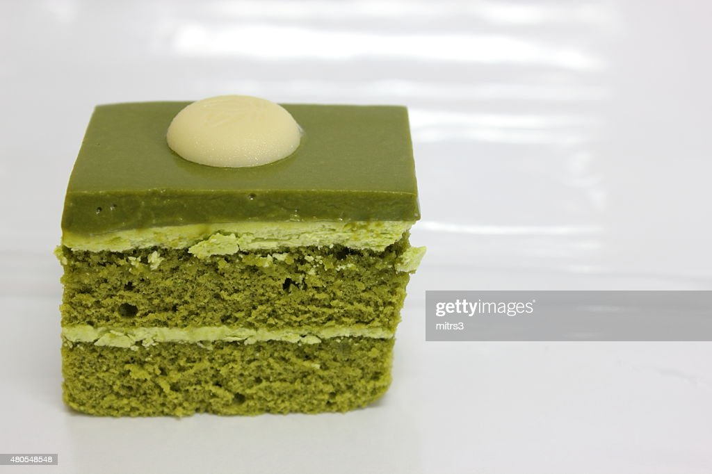 Green tea layer cake on the table. : Stock Photo