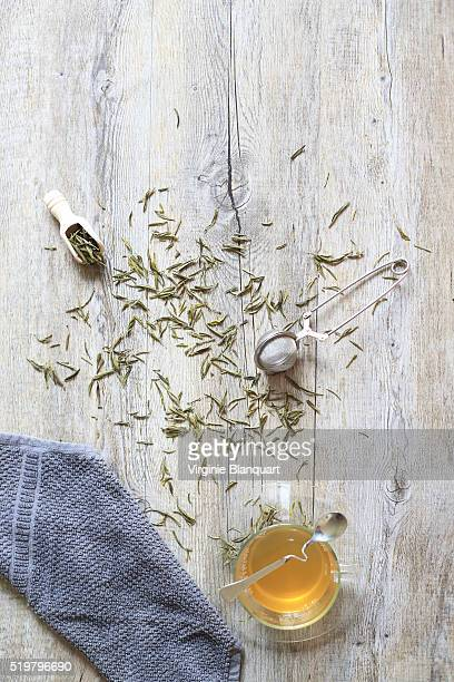 Green tea leaves on a wooden table