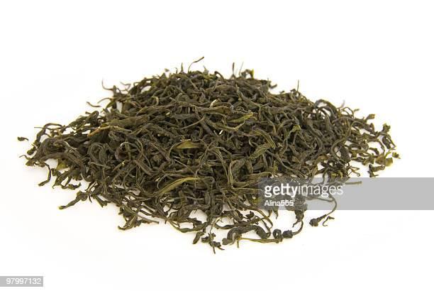 Green tea leaves on white