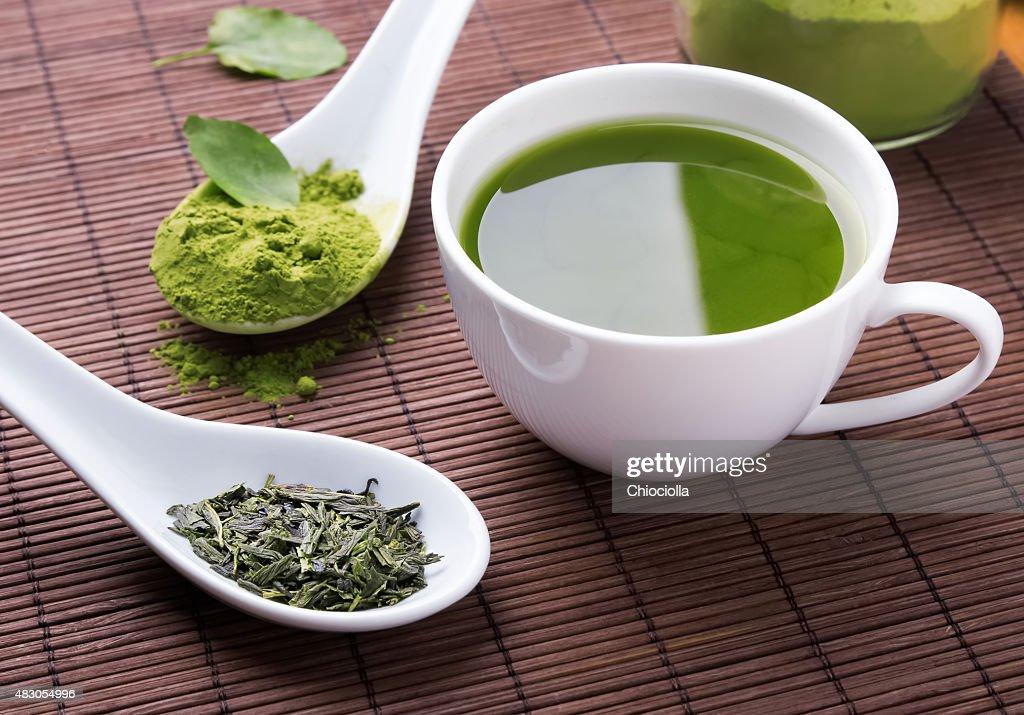 Green tea n the brown mat : Stock Photo