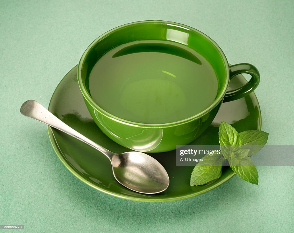 green tea on green background : Stock Photo