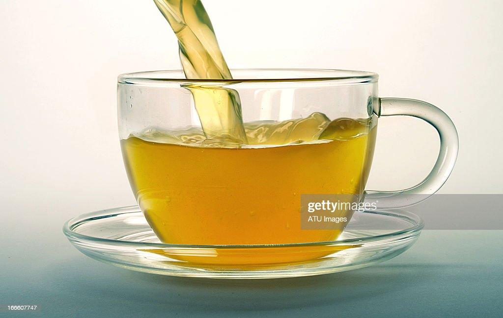 Green tea pouring : Stock Photo