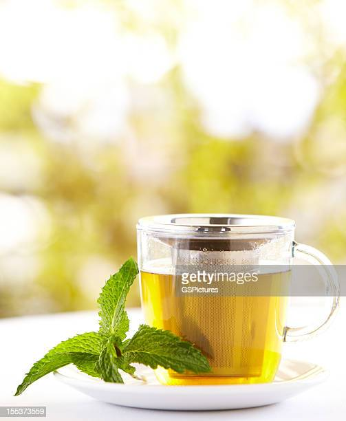 Green tea with a mint leaf outdoors