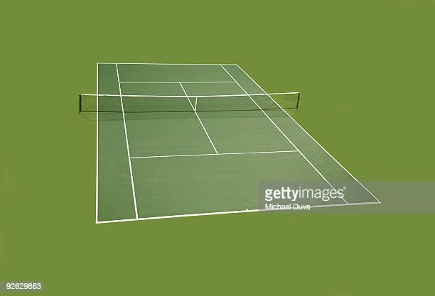 Green tennis court surrounded by green perimeter